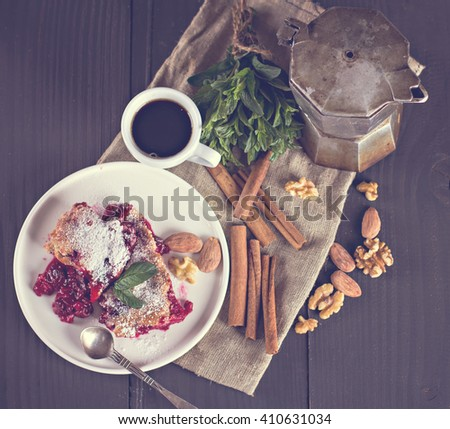 Cherry pie and a cup of coffee. Rustic style. Berry pie. Homemade cherry pie with flaky crust, cup of coffee, bowl with cherries - stock photo