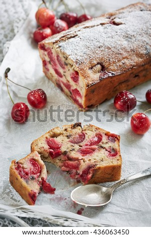 cherry pie sprinkled with sugar powder in the white background - stock photo