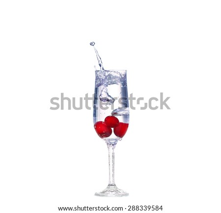 cherry splash in a cocktail glass on white - stock photo