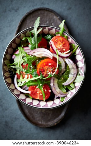 Cherry tomato and arugula salad with sesame seeds - stock photo