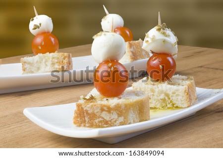 Cherry tomato and mozzarella morsel - stock photo