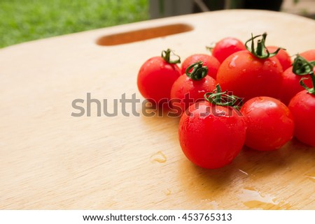 Cherry Tomato fresh group on wooden chopping board.  lycopene and antioxidant in fruit nutrition good for health and skin.