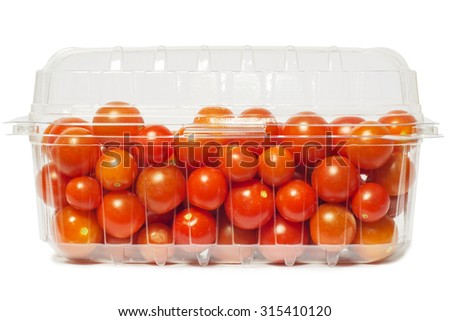 Cherry tomato in plastic package, studio isolated on white - stock photo