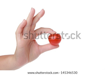Cherry tomato in woman hand - stock photo