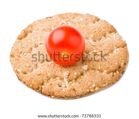Cherry tomato with crisp bread - stock photo