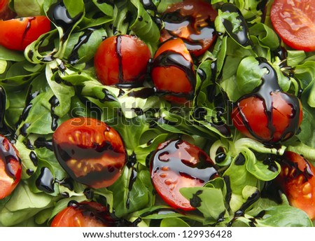 cherry tomatoes and corn salad as background - stock photo