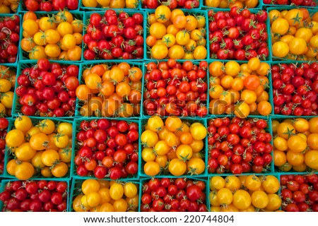 Cherry tomatoes at farmers market display