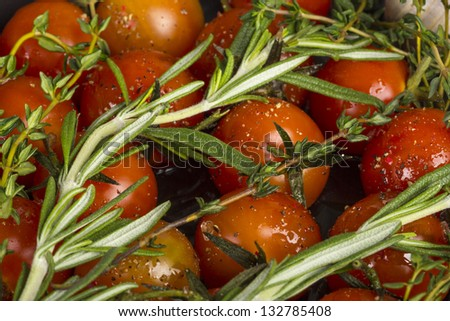 Cherry tomatoes baked with rosemary and garlik - stock photo