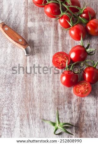 Cherry tomatoes. Cherry tomatoes on vine - stock photo