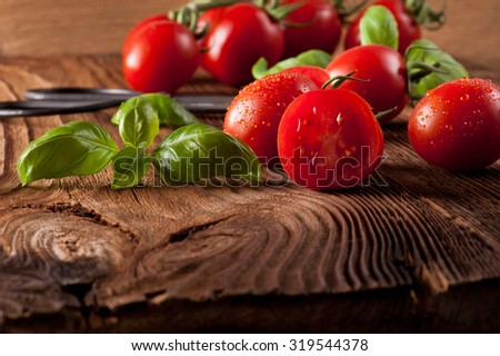Cherry tomatoes. Cherry tomatoes on vine - stock photo
