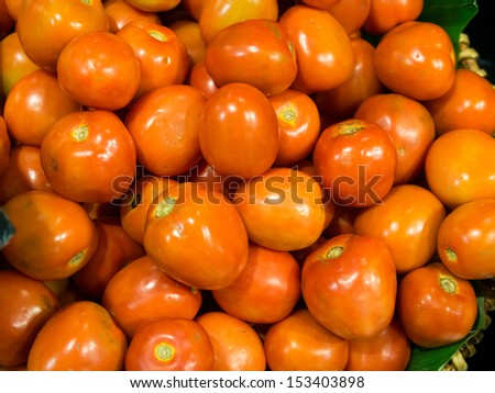 Cherry tomatoes in a pile for sale