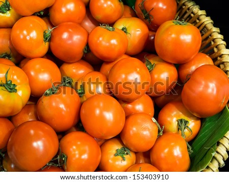 Cherry tomatoes in a pile for sale - stock photo