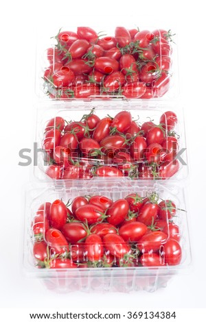 Cherry tomatoes in packaging. Isolated on white background