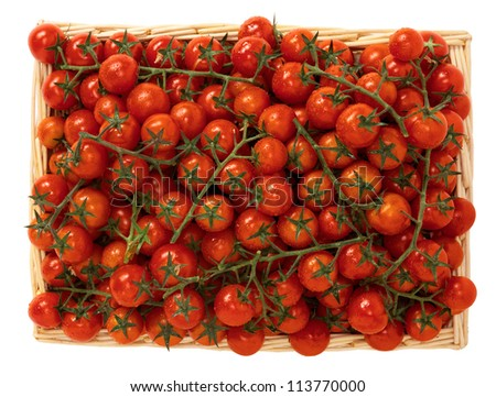 Cherry tomatoes in the basket - stock photo