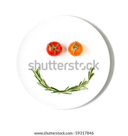 cherry tomatoes making smiley face - stock photo