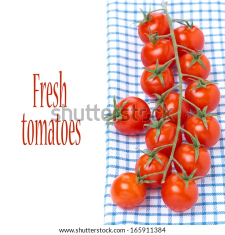 cherry tomatoes on a blue napkin, isolated on white