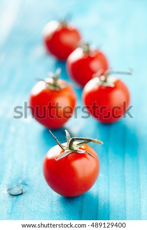 Cherry tomatoes on a blue wooden table