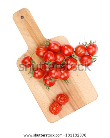 Cherry tomatoes on cutting board. View from above. Isolated on white background - stock photo