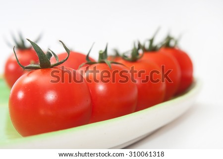 Cherry tomatoes on the green plate.
