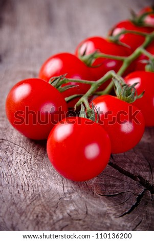 Cherry tomatoes on the rustic wooden board