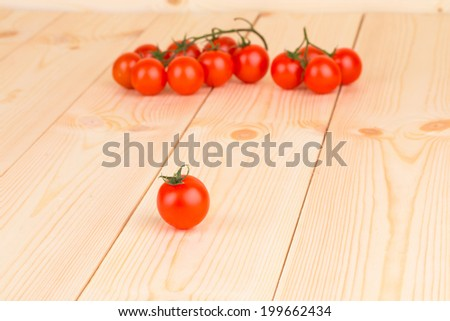 cherry tomatoes on the rustic wooden surface