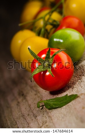 cherry tomatoes on wooden background - stock photo