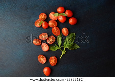 Cherry tomatoes with basil. Top View, copy space - stock photo