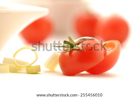Cherry tomatoes with onion rings - stock photo