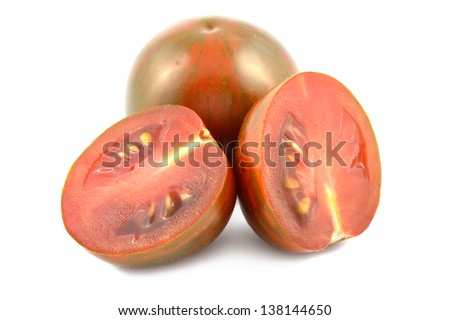 Cherry tomatoes zebra on a white background close-up - stock photo