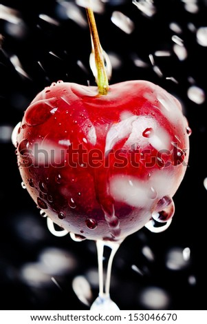 cherry with hits drop of water - stock photo