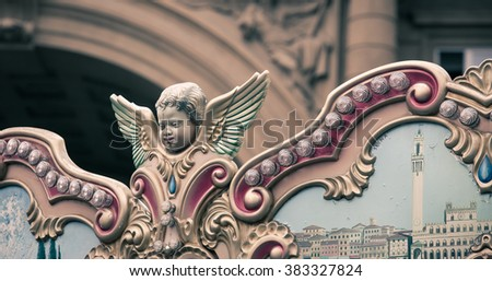 Cherub on a merry go round - stock photo