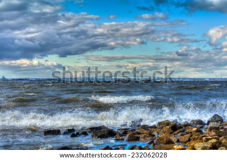 Chesapeake Bay in Maryland on a windy day with Baltimore in the background - stock photo