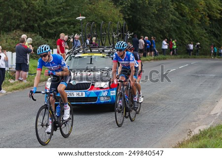 CHESHAM, UK - SEPTEMBER 12: Riders chasing the main peleton head toward the finish line in Hemel Hempstead after cycling from Bath on the Tour of Britain cycling race on September 12, 2014 in Chesham