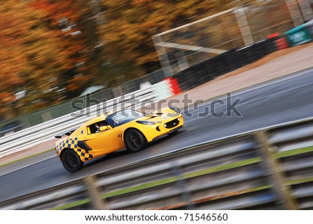 CHESHIRE, ENGLAND - NOVEMBER 12 : Lotus Exige on November 12, 2008 in Cheshire, England, UK. Oulton Park is a Race Track host to Many Automotive Events and Track Test Days - stock photo