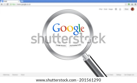 CHESHIRE - JUNE 29, 2014: Photo of Google homepage on a monitor screen through a magnifying glass.