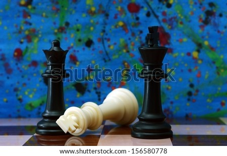 Chess against colorful background - stock photo