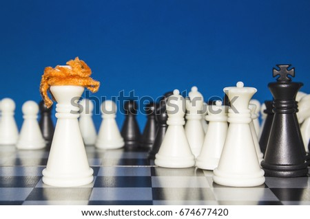 Chess as a policy. A lone white figure with red hair against the white and black figures with the team. The public looks from the outside.