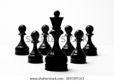 Chess black king and six black pawns on a white background