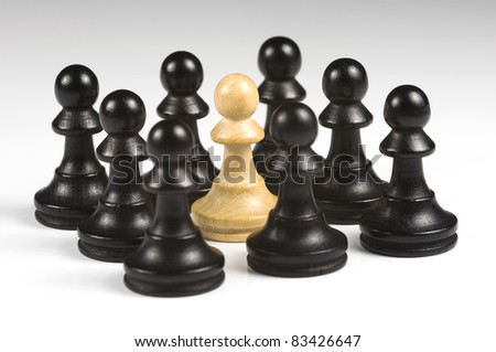 Chess black pawns with white pawn