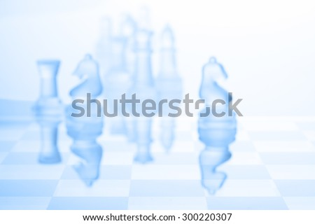 Chess blur focus on blue background