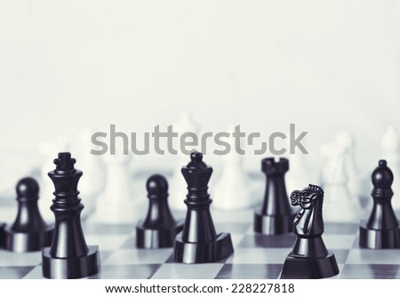 Chess board selective focus (focus on knight in foreground) - stock photo