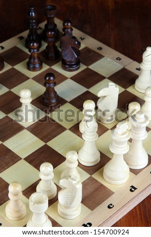 Chess board with chess pieces close-up - stock photo