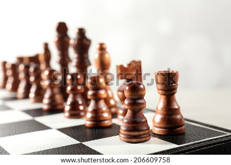 Chess board with chess pieces isolated on white - stock photo