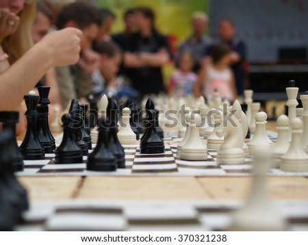 Chess competition. game with many rivals - stock photo