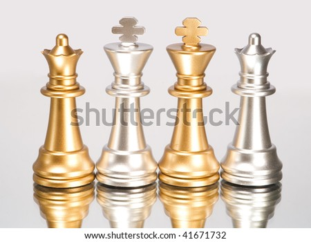 Chess figure and mirror on a grey background