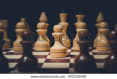 Chess figure pawn. Close-up on a chess board - stock photo