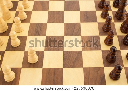 chess figures on board background - stock photo
