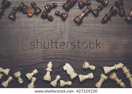 chess figures on the brown woden table background - stock photo