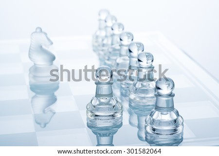 chess figures - strategy and teamwork concept - stock photo