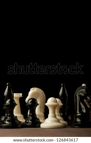Chess game on wooden table